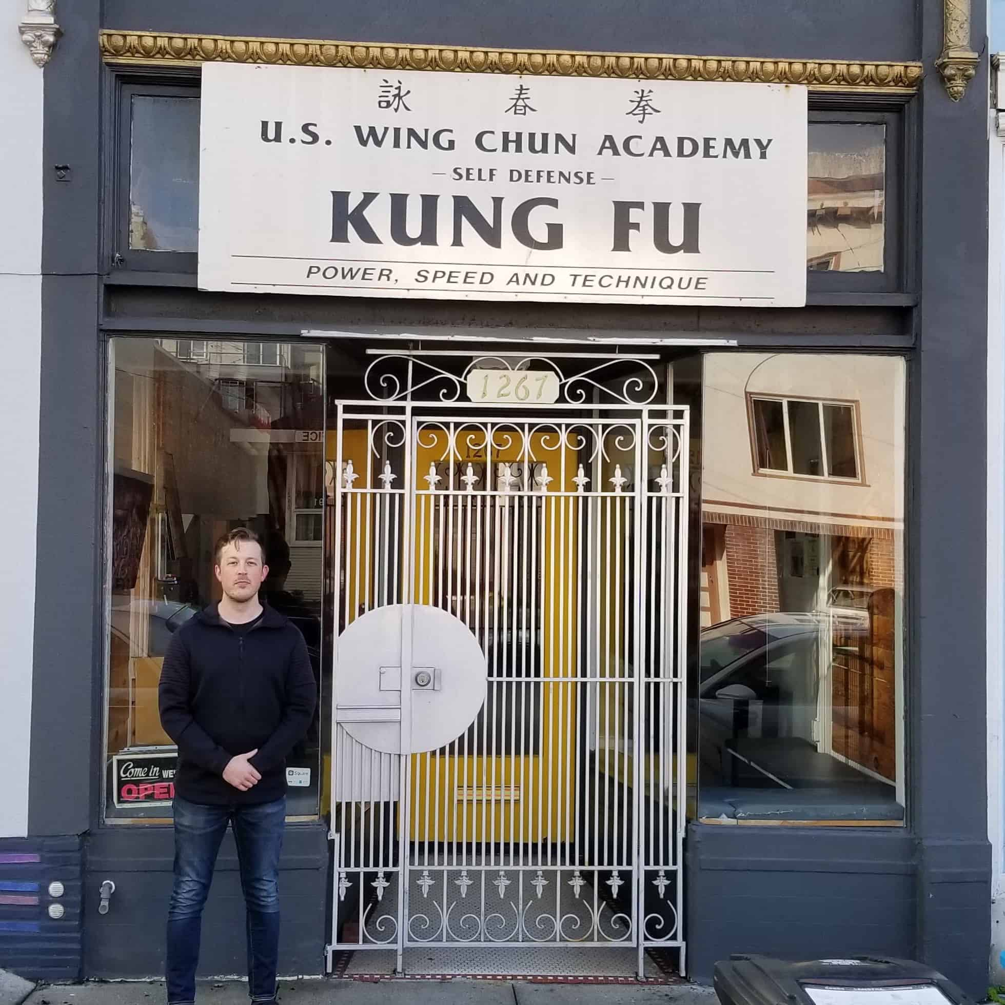 Jonathan Pritchard standing in front of the US Wing Chun International location